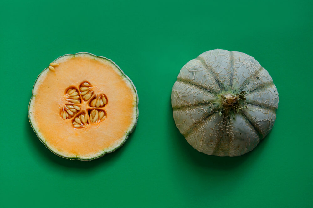 fresh-cantaloupe-on-a-bright-green-background--1-