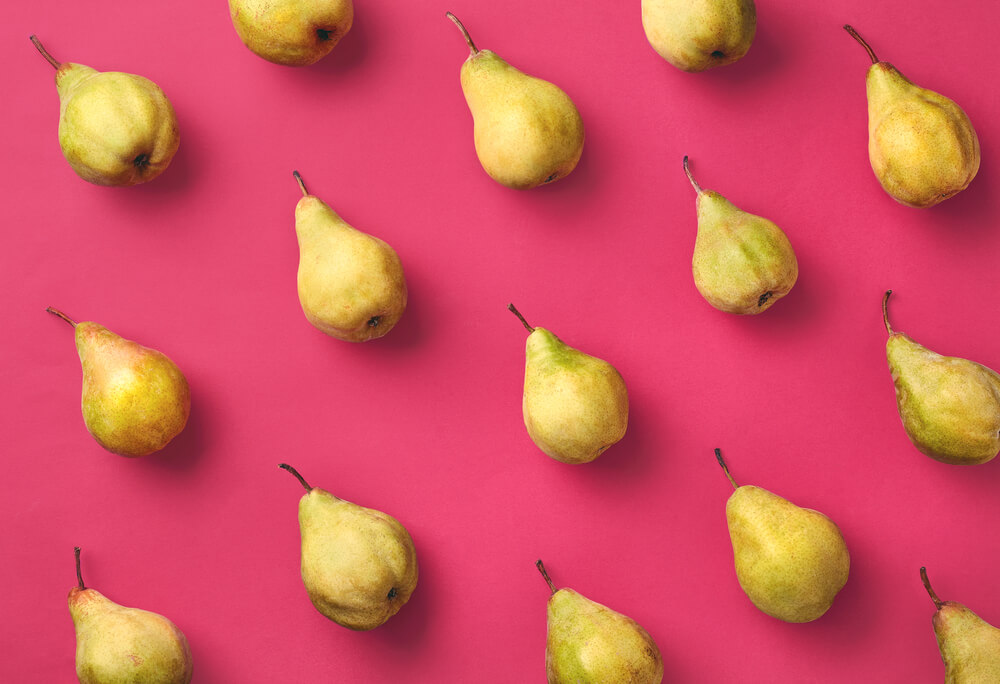 fresh-pears-on-bright-pink-background