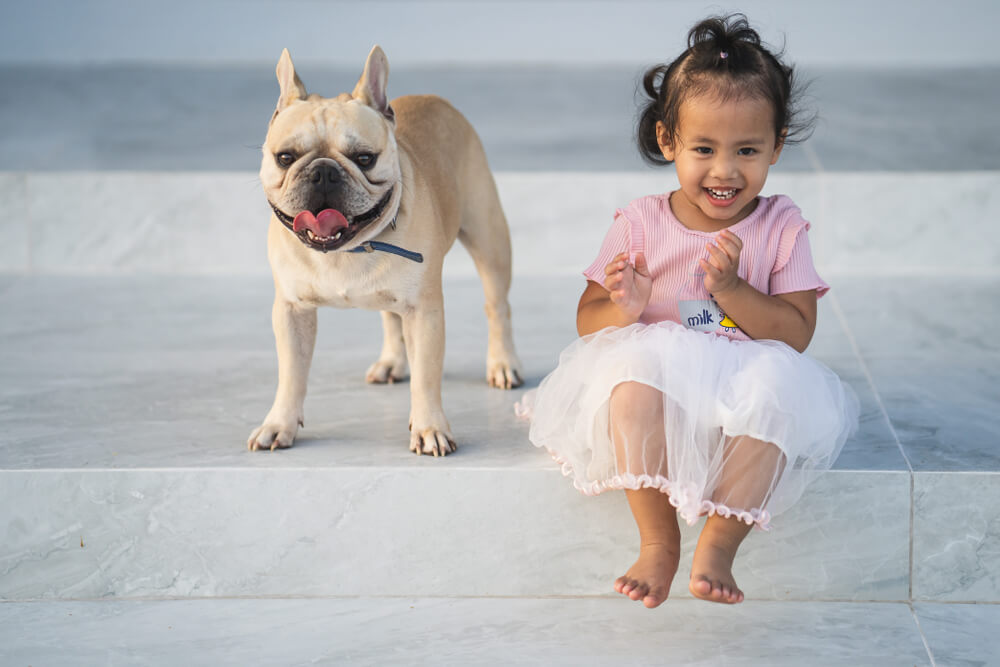 little-girl-smiles-with-her-pet-bull-dog