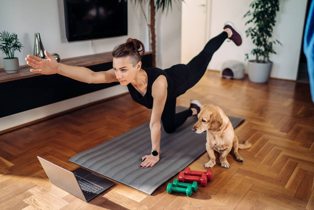 woman-exercises-at-home-with-her-dog