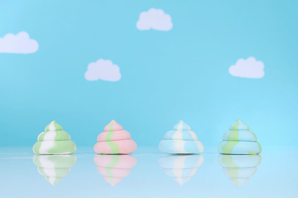 colorful-marshmallow-poop-in-front-of-a-blue-sky-background