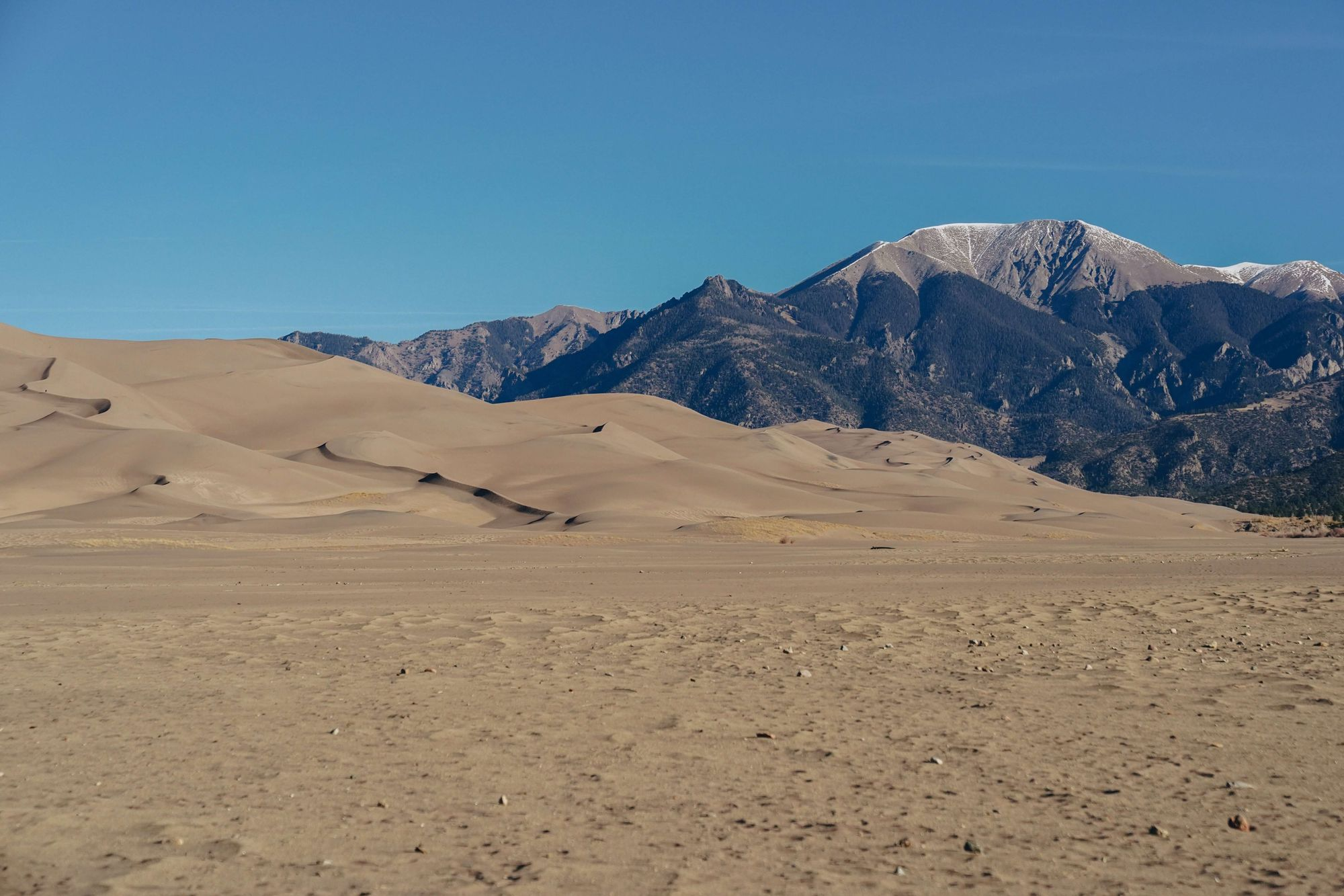 Great-Sand-Dunes-National-Park-and-Preserve-with-a-clear-blue-sky